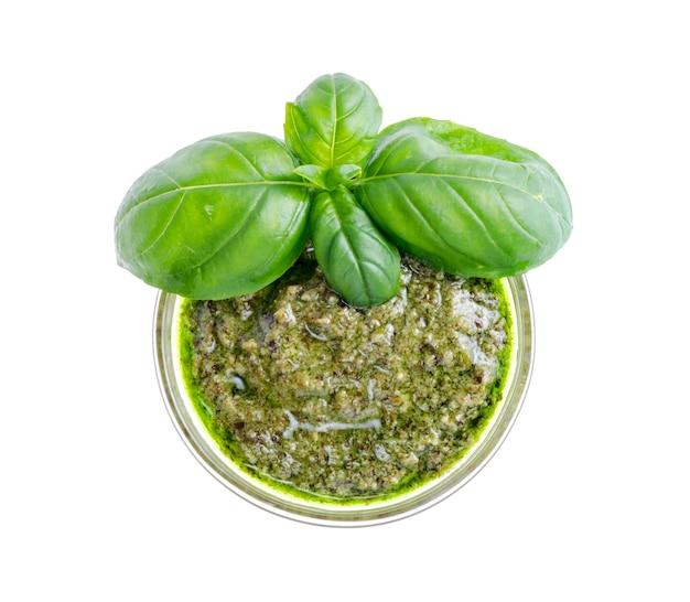 Pesto sauce and fresh green basil leaves.