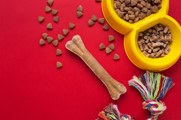 Pet accessories on red background. top view. still life. copy space
