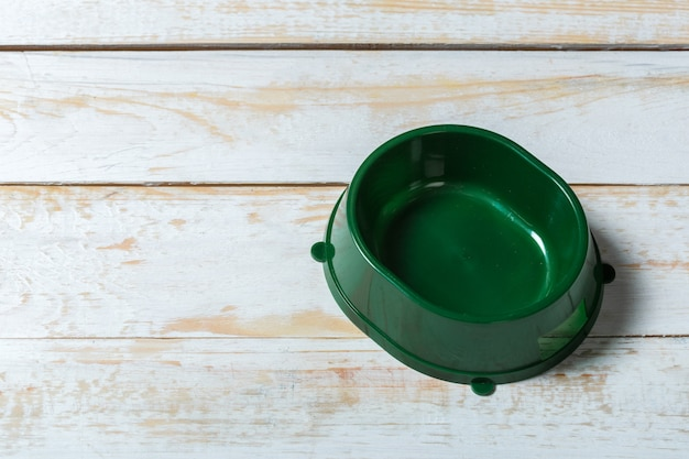 Pet bowl on a grey wooden table Premium Photo