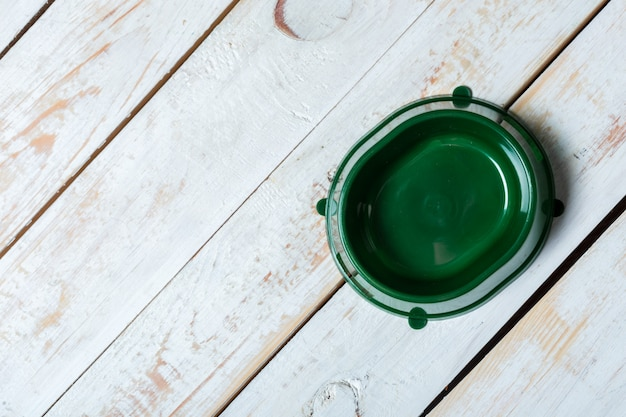 Pet bowl on a grey wooden table