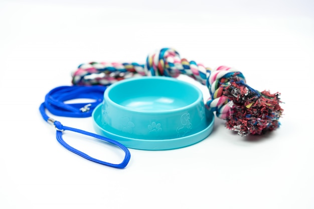 Pet bowl and leashes with toy on isolated white