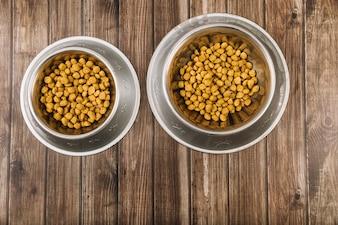 Pet bowls on lumber floor