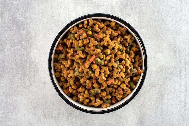 Pet food in a bowl on a gray surface