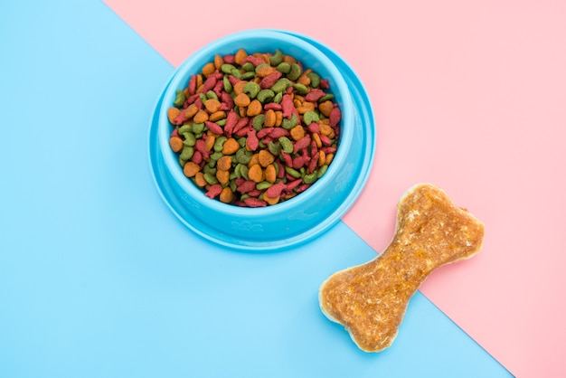 Pet food and snack with copy space on color background
