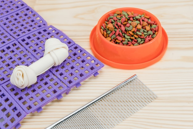 Pet food and snack with copy space on wooden table
