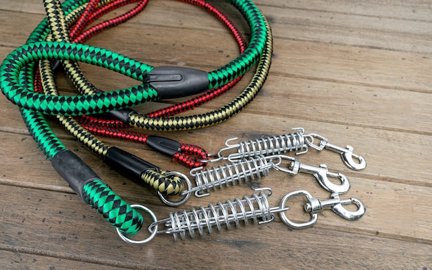 Pet leashes for dog or cat on wooden table