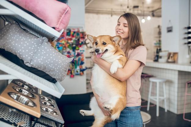Pet shop.pet owner choosing a pet bed in a pet shop