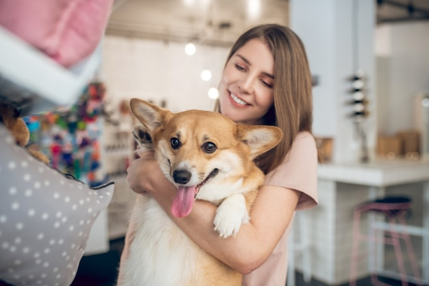 In a pet shop. a smiling girl choosing animal accessories in a pet shop