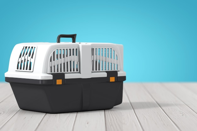 Pet travel plastic cage carrier box on a wooden table. 3d rendering