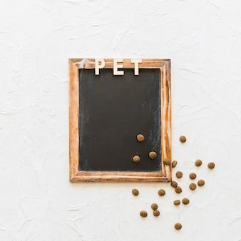Pet writing and dry food on blackboard