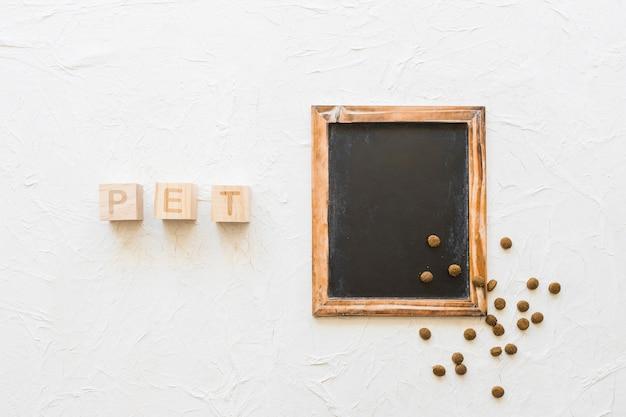 Pet writing near chalkboard and food