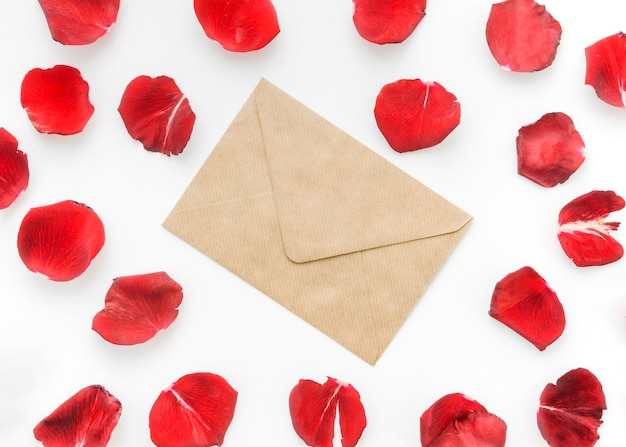 Petals of red roses with letter