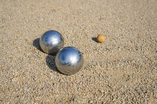 Petanque ball on the ground field