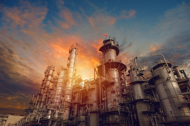 Petrochemical industrial plant on sunset sky background