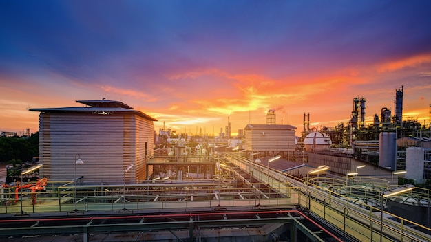 Petrochemical industry plant at sunset, manufacturing of oil refinery industrial