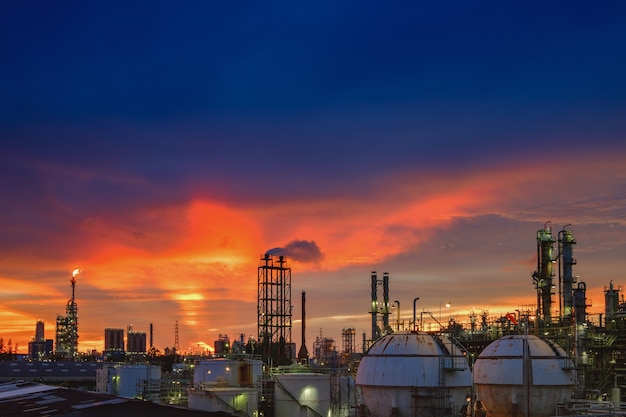 Petrochemical industry plant at sunset, manufacturing of refinery industrial
