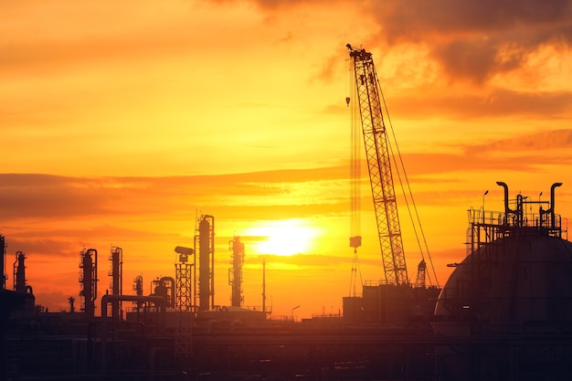 Petroleum industry plant with sunset sky, silhouette image of petrochemical industrial plant