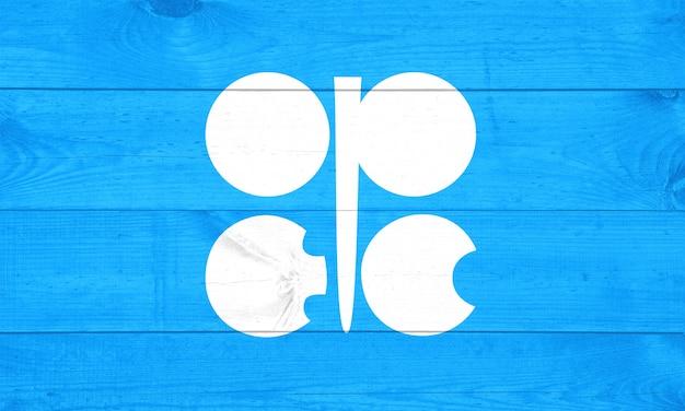 석유, 석유 달러 및 원유 개념 : opec 또는 석유 수출국 조직의 국기에 세계 지구본은 세계 석유 산업의 개발 또는 생산에 대한 투자를 묘사합니다.