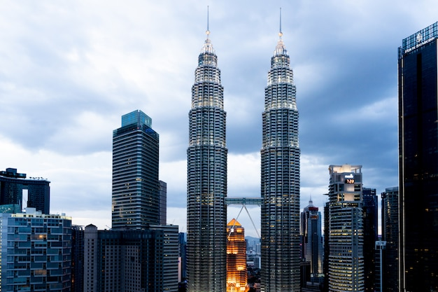 Petronas towers and skyscrapers in the city of kuala lumpur during sunset