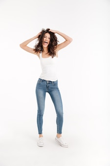 Pfull length prtrait of a funny woman dressed in tank-top