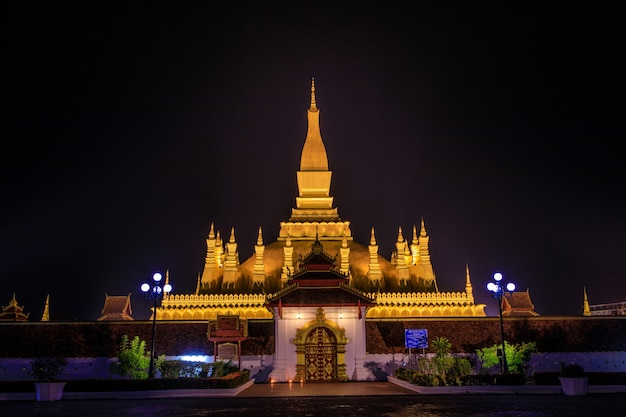 Pha that luang a gold buddhist stupa in the night
