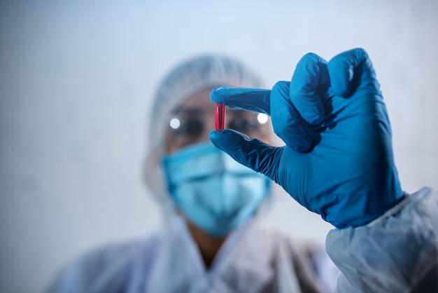 Pharmaceutical researcher finds a solution to coronavirus. concept of medical research