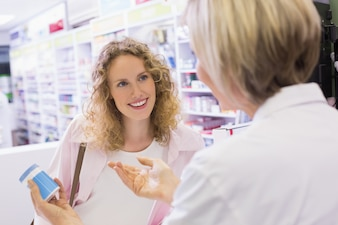 Pharmacist and her customer talking about medication