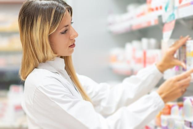 Pharmacist checking drug in a pharmacy