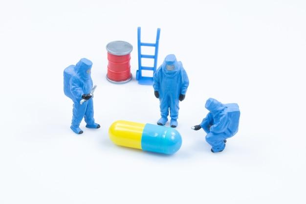 Pharmacist scientists check quality drug capsule