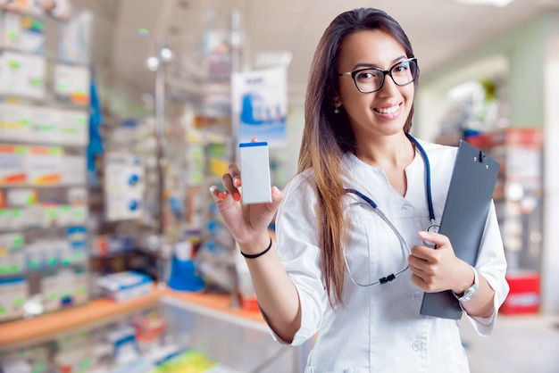Pharmacist showing medication at the pharmacy