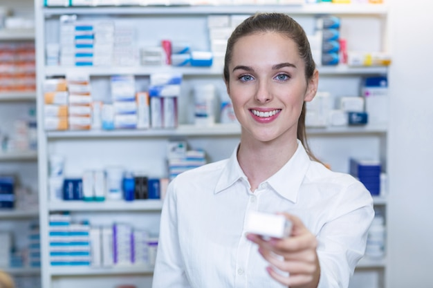 Pharmacist showing a medicine in pharmacy