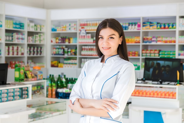 Pharmacist with her arms crossed and smiling
