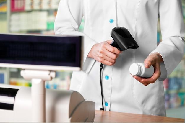 Pharmacologist sell drug bottle in drugstore