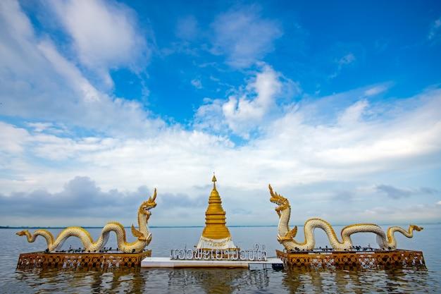 Phayao, thailand -jan 01, 2020 the naga statue in phayao lake (kwan phayao) with blue sky background.