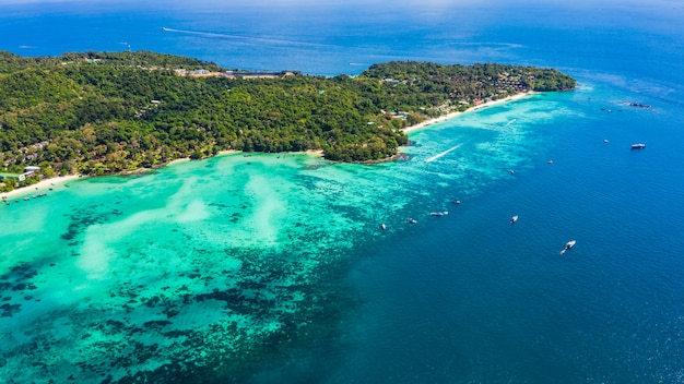 Phi phi island and diving tourist boat high season in thailand aerial view