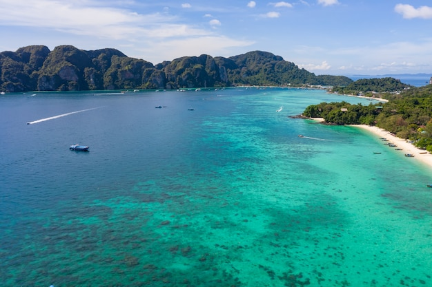 Phi phi island and  tourist boat aerial view