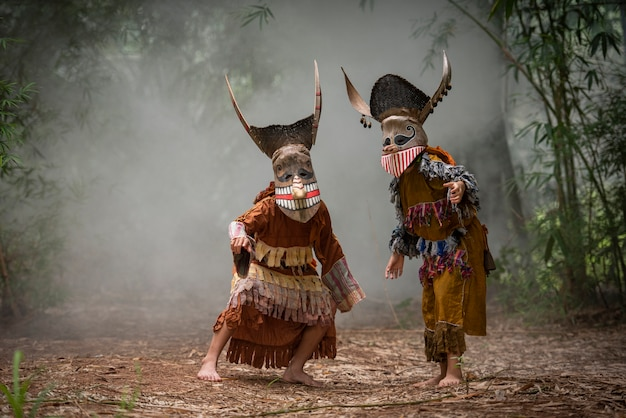 Phi ta khon festival ghost mask and colorful costumes