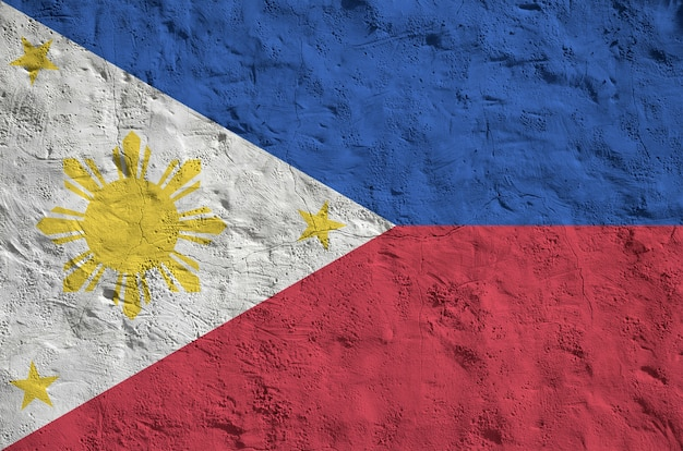 Philippines flag depicted in bright paint colors on old relief plastering background
