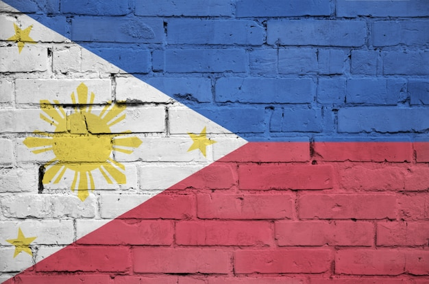 Philippines flag is painted onto an old brick wall