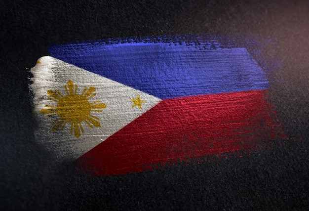 Philippines flag made of metallic brush paint on grunge dark wall