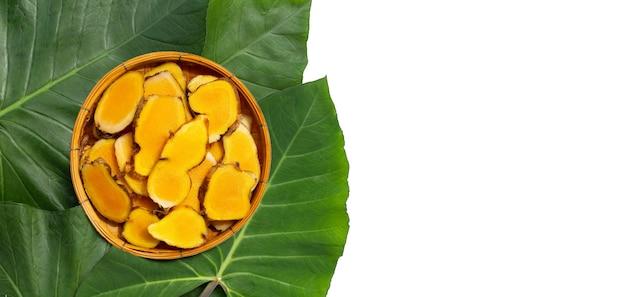 Phlai slices, cassumumr ginger or zingiber montanum in bamboo basket on taro leaves