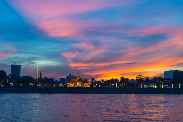 Phnom penh skyline at sunset capital city of cambodia kingdom, panorama silhouette view  from mekong river, travel destination, dramatic sky