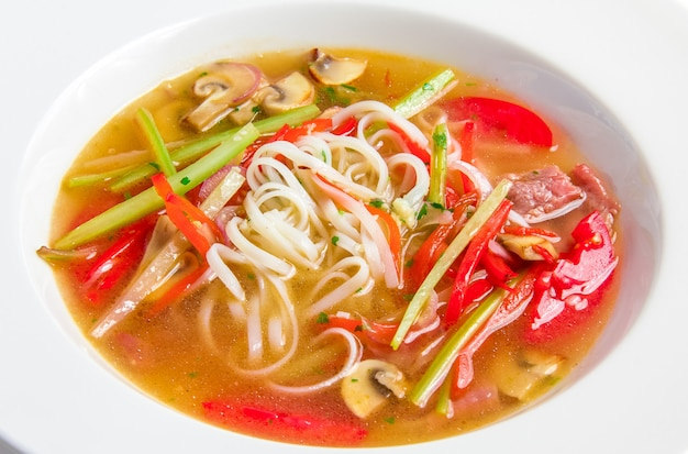 Pho bo, vietnamese soup with rice noodles, beef and mushrooms