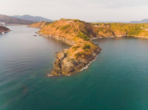 Phomthep or promthep cave icon of phuket, thailand. aerial view from drone camera of phromthep cave view point at phuket.