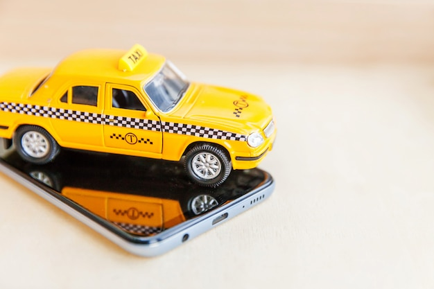 Phone application of taxi service for online searching calling and booking cab concept.