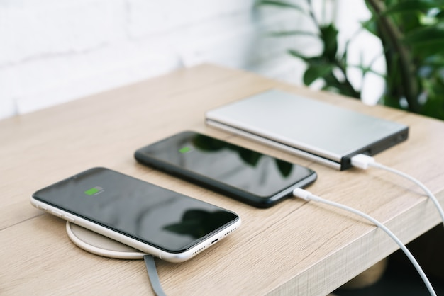 Phone charging battery on wireless and external power supply