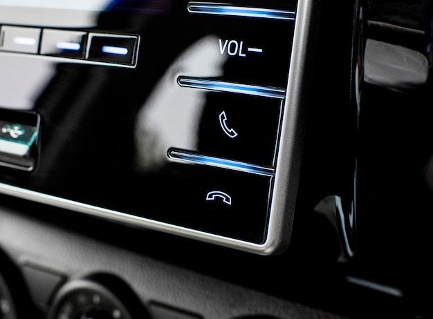 Phone control buttons in the multimedia control panel in luxury car.