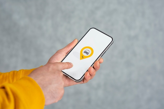 Phone display with taxi icon on light background.