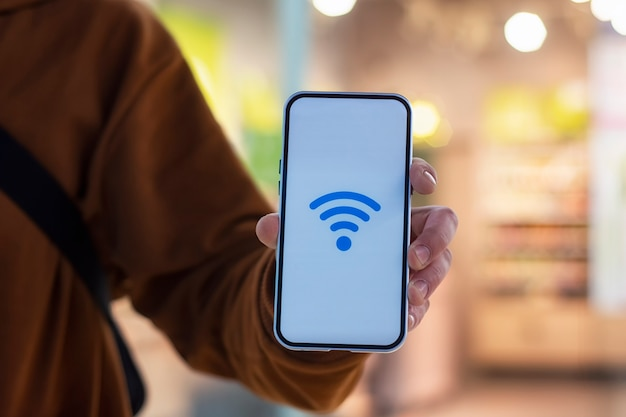 Phone display with wi-fi icon against the backdrop of a shop window