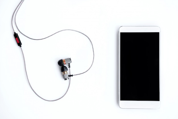 Phone and headphones on a white